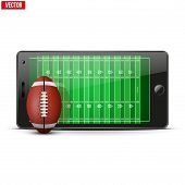 Mobile phone with football ball and field on the screen.