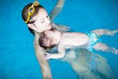 Mother and baby relaxing in a swimming pool
