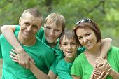 Cheerful family in green shirts