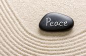 A black stone with the inscription Peace