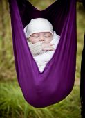 Baby hanging in sling
