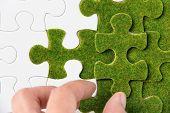 green puzzle piece concept