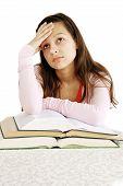 Teenage Girl Dreaming Over Books