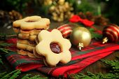 pic of christmas cookie  - Christmas cookies with flowers shape on a wooden table with christmas balls and cedar branch - JPG