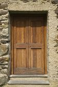 Barn door of wood secured