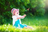 Toddler Girl Playing With Butterfly