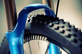 Mountain bike suspension fork and front wheel with tyre