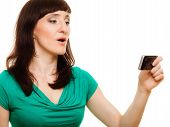 Surprised Woman Reads Message On Her Mobile Phone