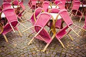 Closed Outdoor Cafe Terrace With Pink Chairs