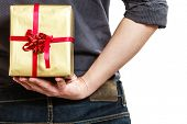 Holiday. Man Hiding Surprise Gift Box Behind Back