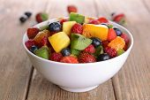 Delicious fruits salad in plate on table close-up
