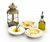 Arabic traditional Hummus , labneh and mtabbal with Ramadan Lamp