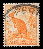 AUSTRALIA - CIRCA 1959: Orange color postage printed in Australia with image of a Kangaroo (First print 1937).