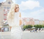 Beautiful young woman in the city