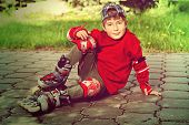 picture of 7-year-old  - Cool 7 year old boy rollerblades on the street - JPG