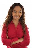 stock photo of mixed race  - Stock image of woman standing with her arms crossed over white background - JPG