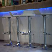 Close-up Of Bar Stools At Illuminated Bar