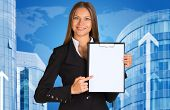 Businesswoman with buildings and world map