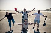 Funny People Imitating Airplane At Airport Runway
