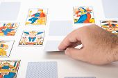 stock photo of clairvoyance  - Zoom in Clairvoyance tarot cards on white background - JPG