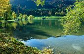 Autumnal Lakeside Of Lake Schliersee, Reflecting Hills In The Water