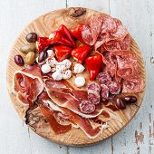 Cold Meat Plate And Olives On Wooden Background