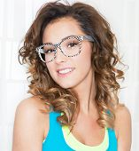 Young attractive woman wearing checkered glasses