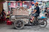man driving delivery tricycle