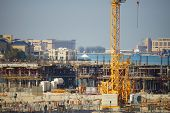DUBAI - December 12, 2013: Large construction site for a new mall at the beach. United Arab Emirates.