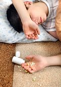 picture of home remedy  - Teenager sleeps near the scattered Pills on the Bed at the Home - JPG