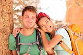 Hiking young couple portrait of happy hikers in Bryce Canyon walking smiling happy together. Multira