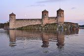 Savonlinna.  Fortress Olavinlinna At Sunset