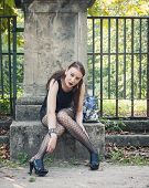 Pretty Goth Girl Sitting In A City Park