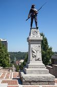 stock photo of confederation  - Confederate soldier statue and memorial at top of Monument Terrace added in 1900 - JPG