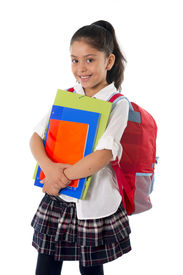 picture of schoolgirl  - happy sweet little schoolgirl carrying schoolbag backpack and books smiling in children education and back to school concept isolated on white background - JPG