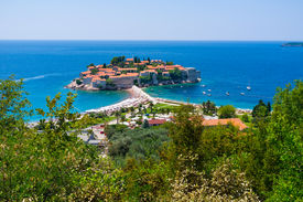 picture of former yugoslavia  - The former fishing village located on the stone islet became the luxury resort with cozy sand beaches and shady gardens Sveti Stefan Montenegro - JPG
