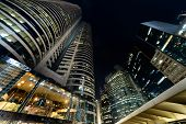 City night scene with business office skyscrapers in Hong Kong, China, Asia.