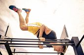 picture of body builder  - Young athlete training at bar  - JPG