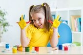 kid girl showing painted hands