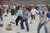 People practice tai chi chuan gymnastics in Beijing, China.