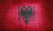 Albania flag on burlap fabfic