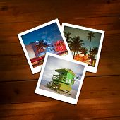 Vintage photos of travel memories on a wooden background.