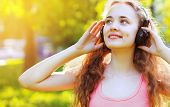 Music, Summer, Leisure And People Concept - Lifestyle Portrait Pretty Young Girl With Headphones Lis
