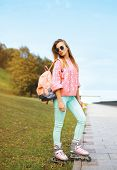 Fashion, Extreme, Youth And People Concept - Pretty Stylish Hipster Woman In The City Park, Cool Rol