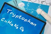 Tablet with the chemical formula of Tryptophan