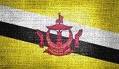 Brunei flag on burlap fabric
