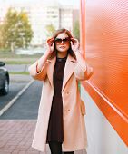 Beauty, Fashion And People Concept - Pretty Stylish Woman In Coat And Sunglasses Outdoors In The Cit poster