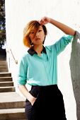 Skinny Asian American Woman Outdoors Pants And Shirt