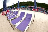 Deck Chairs On The Beach.