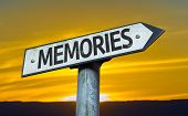 Memories sign with a sunset background
